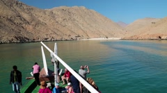 People on a pleasure boat near the coast of Musandam peninsula in Oman - stock footage