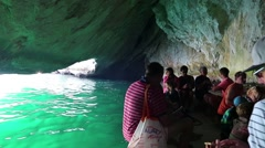 People on motorboat in grotto, Musandam peninsula, Sultanate of Oman - stock footage