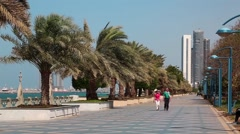 People at the Corniche road in Abu Dhabi, United Arab Emirates Stock Footage