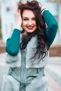 Beauty Fashion Model Girl in Fox Fur Coat. Beautiful Woman in Luxury Gray Fur Stock Photos