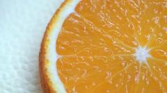 Slice of orange fruit rotation on white background Stock Footage