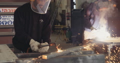 Metal workers cutting and welding machine parts Stock Footage