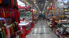 Shopping arcade of Chinese souvenirs in the HongQiao Pearl Market. Beijing Stock Footage