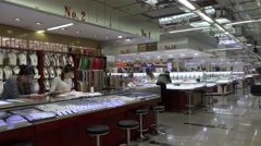 Jewelry shopping arcade in the HongQiao Pearl Market. Beijing, China Stock Footage
