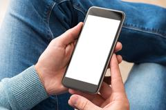 Smartphone in man's hands. Clipping path included - stock photo