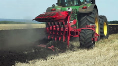 Land cultivation. Tractor prepares land for sowing. Stock Footage
