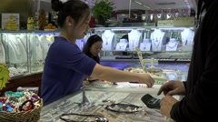 Tourists buy jewelry in the HongQiao Pearl Market. Beijing, China Stock Footage
