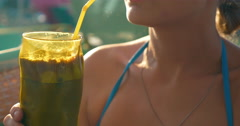 Woman Drinking Ice Coffee in Hot Day Stock Footage