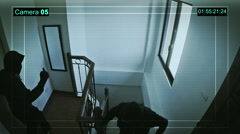 Unknown male robbers entered the house and hit the CCTV recording. Stock Footage