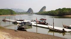 Krabi river boat dock skyline with karst hills Stock Footage
