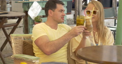 Couple Drinking Ice Coffee and Talking Stock Footage