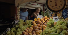 Couple choosing tomatoes on street market - stock footage