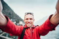 Man take his journey selfie photo with wide angle camera - stock photo