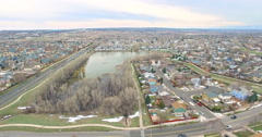 Aerial view of urban park with business park and apartment complex. Stock Footage