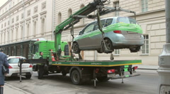 A tow truck lifts an illegaly parked car Stock Footage