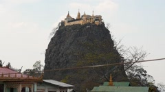 Popa hill and monastery on it - Myanmar - camera motion up Stock Footage