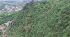 CINEMATIC AERIAL TILT SHOT OF LI RIVER AND GUILIN SCENIC COUNTRYSIDE HILLS Stock Footage