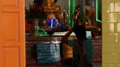 Woman praying in Buddhist temple - Popa Hill, Myanmar Stock Footage