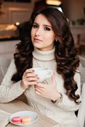 Coffee. Beautiful Girl Drinking Tea or Coffee. Cup of Hot Beverage. Brunette in Stock Photos