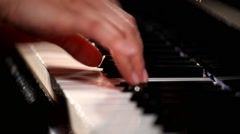 hands close up playing grand piano - stock footage