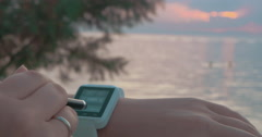 Using Smart Watch on the Beach - stock footage