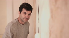 Adult Man painting wall in new home - stock footage