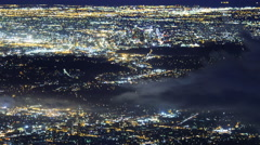 Time Lapse of Aerial View of LA City Lights with Fog -Pan Right- Stock Footage