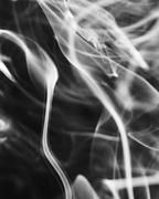 Rough Tendrils of Smoke in a Dark Room - stock photo