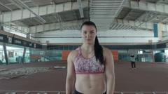 One caucasian woman javelin thrower on stadium Stock Footage