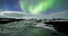 Northern Lights above a lagoon with iceberg timelapse Stock Footage