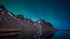 Northern Lights above a mountain and lake in Iceland, Hofn lake Stock Footage