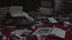 Messy place full of books and paper pan shot Stock Footage