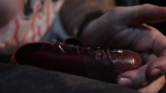 Shoemaker sews shoes. Hammering shoe leather Stock Footage