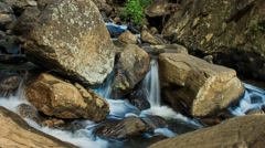 Timelapse video of water passing through large rocks. Stock Footage