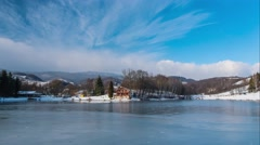 Winter timelapse - frozen lake and chalet in the background. Stock Footage