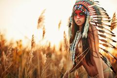 Beautiful girl in a suit of the American Indian - stock photo