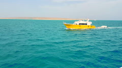 Yellow yacht floating in the azure sea - stock footage