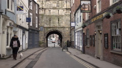 York England old town ancient stone arch couple with dog 4K Stock Footage