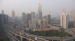 Urban China, central Shanghai, elevated highway, city skyline, metropolis - stock footage