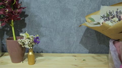 Man Chooses A Bouquet In Flower Shop - stock footage
