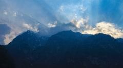 Timelapse of sun hiding behind the peaks of Himalaya Stock Footage