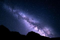 Mountain landscape with Milky Way. Night starry sky - stock photo