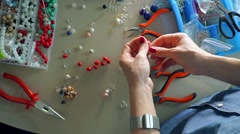 Work place of accessories artist making bead earrings, view from above Stock Footage