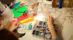 Workplace of a necklace artist, view from above Stock Footage