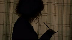 Young woman takes note on her diary and wishes for good Stock Footage