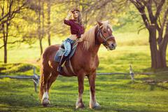 Cowgirl and Horse. Retro Style - stock photo