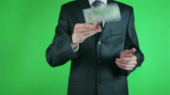 Handsome young man catching money on chroma key Stock Footage