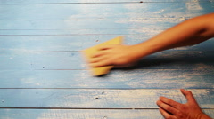 An accelerated footage of a person polishing the wooden board with sandpaper Stock Footage