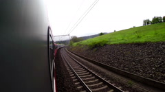 An on-board camera footage: landscape sweeps along as the train continues riding Stock Footage