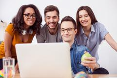 Cheerful four colleagues are entertaining themselves - stock photo